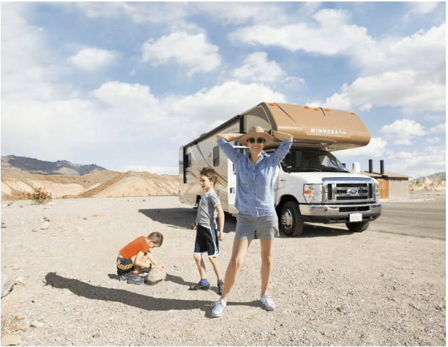 Parent and children in front of RV rental