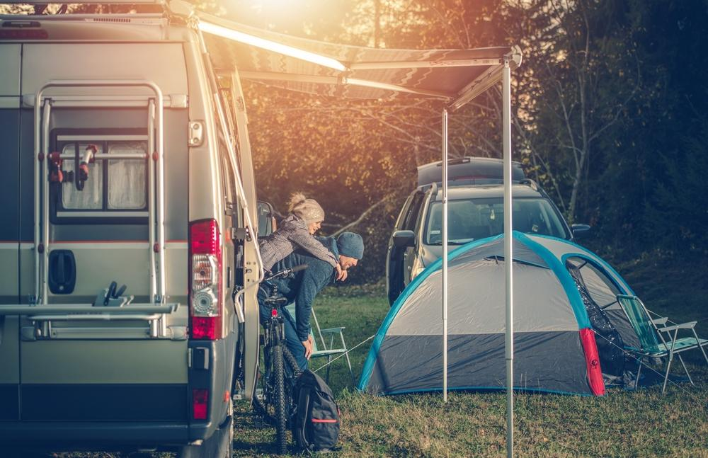 Father and daughter next to their RV rental