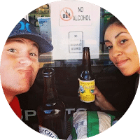 Photo of husband and wife drinking a beverage